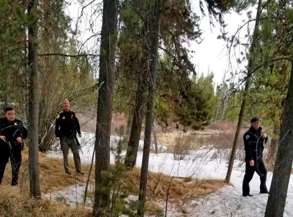 """<p>Police officers are seen near the site of a grizzly bear mauling just outside Yellowstone National Park in Montana. Authorities said Charles """"Carl"""" Mock died on Saturday of injuries sustained in the attack</p>"""