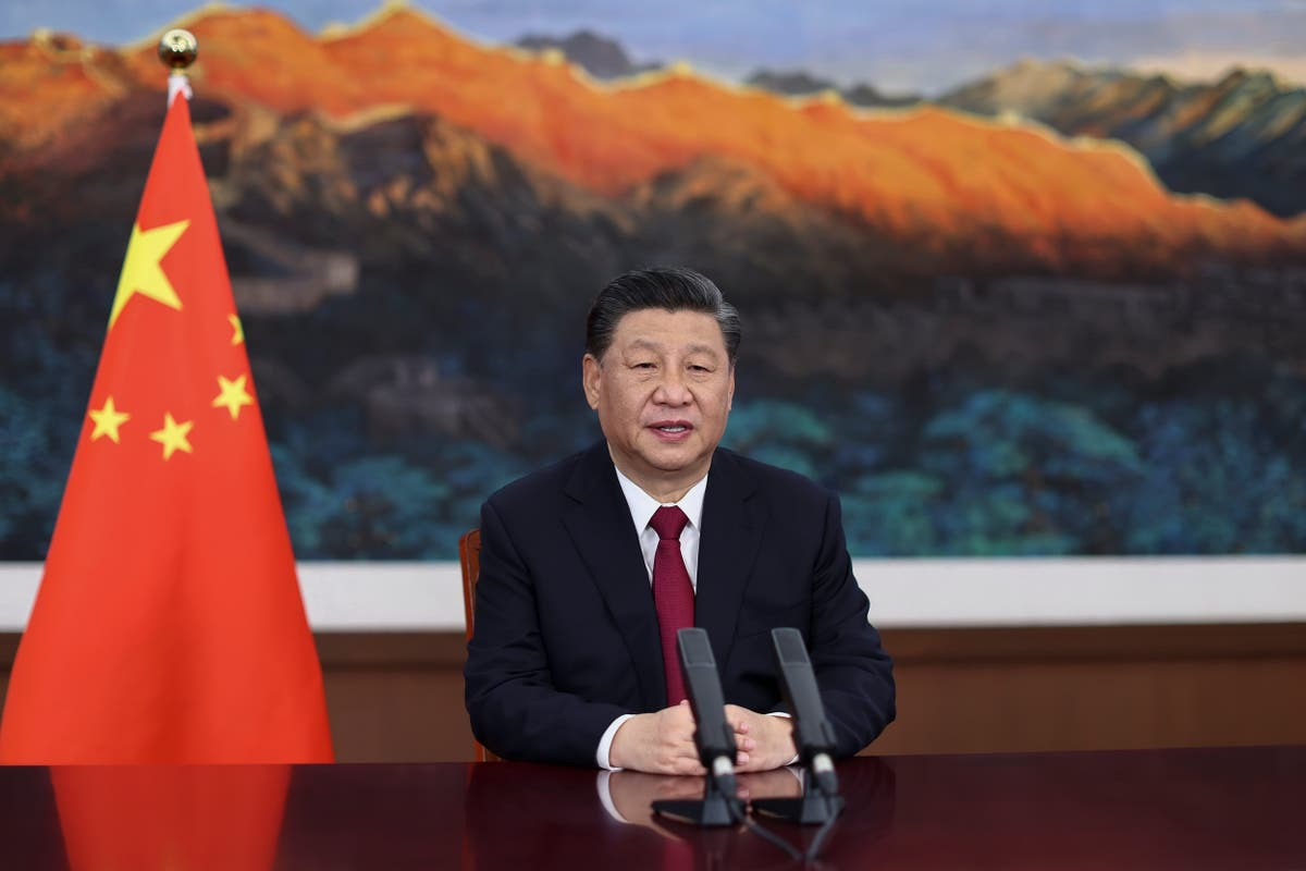 Amid US strains, China's Xi warns against 'unilateralism' Washington Davos Switzerland Japan Communist Party