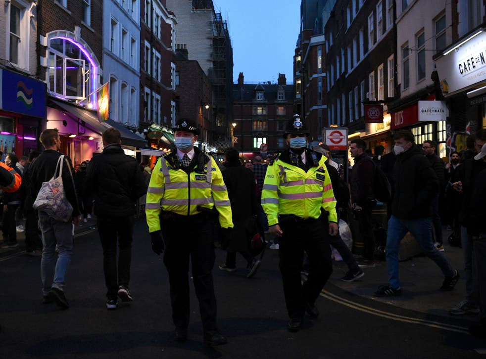 Police Officers in central London, on the first Friday evening after pubs in England were allowed to reopen to serve customers outside