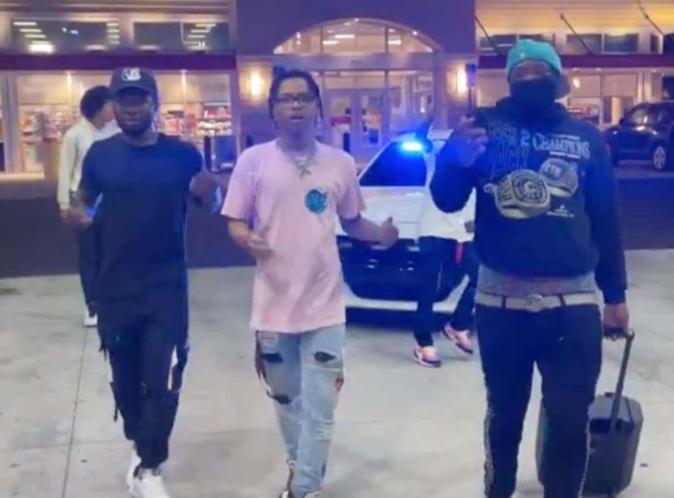 <p>One of the friends was nudged by a police car as the group performed a dance routine</p>