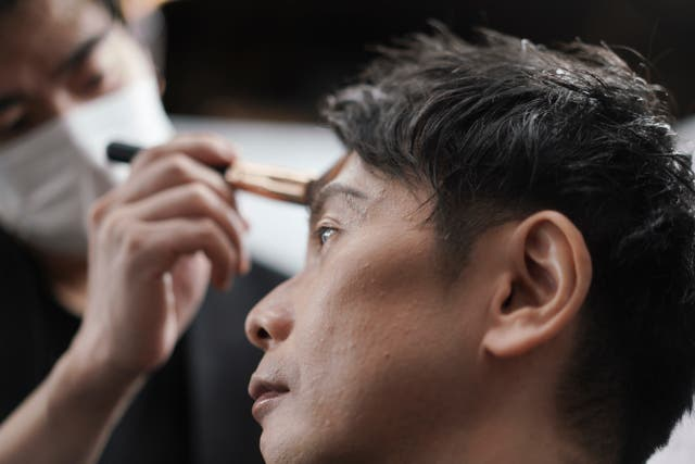 <p>A man gets his make-up done at a salon in Tokyo.  Businessmen have been visiting them in increasing numbers during the pandemic</p>
