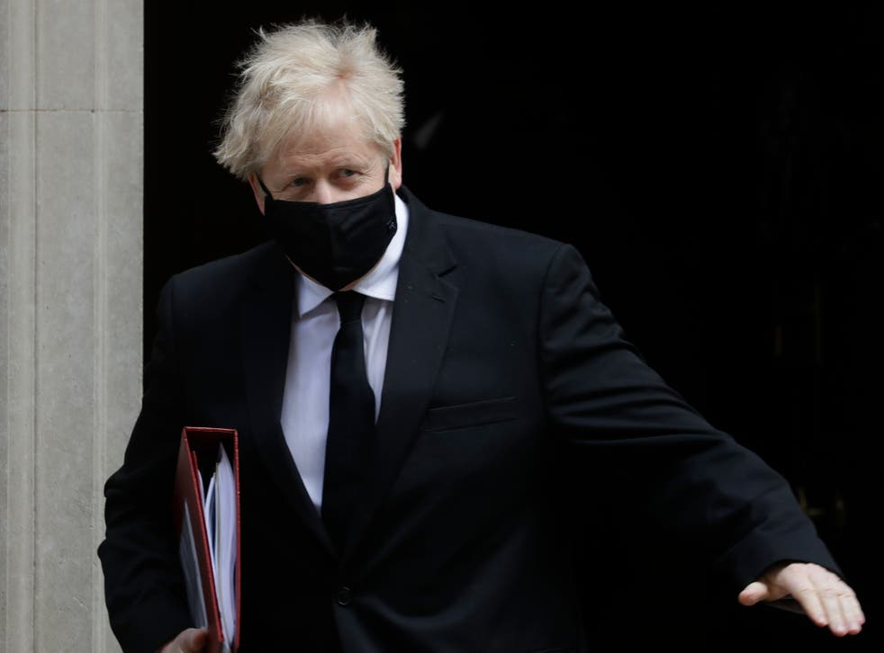 <p>Boris Johnson leaves the building that includes a tastefully refurbished flat</p>