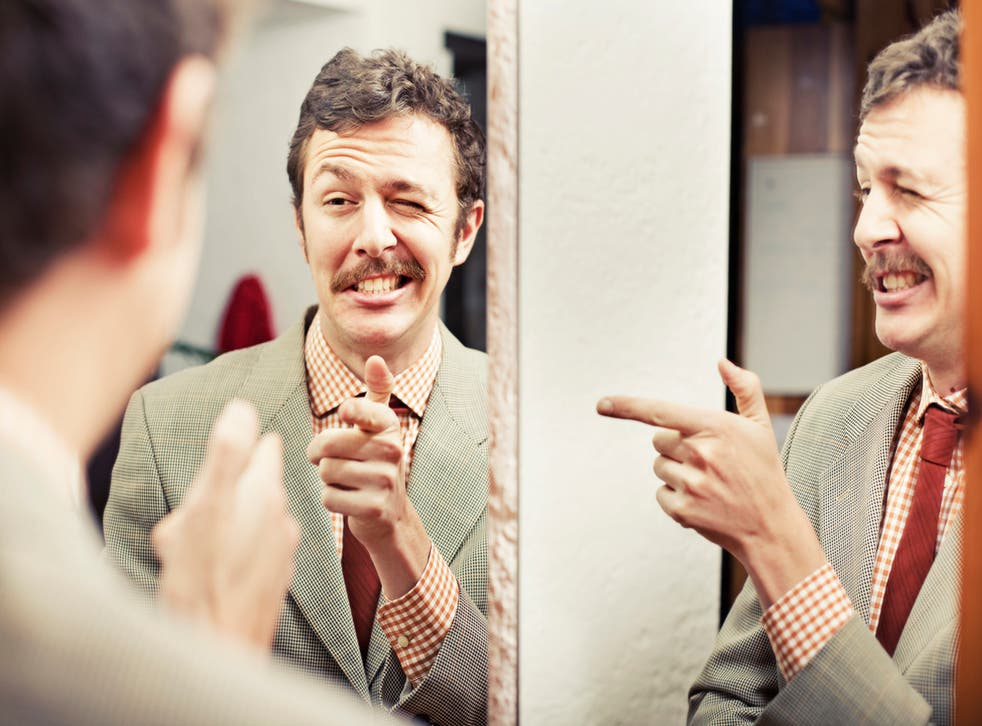 narcissist thumbs up in the mirror
