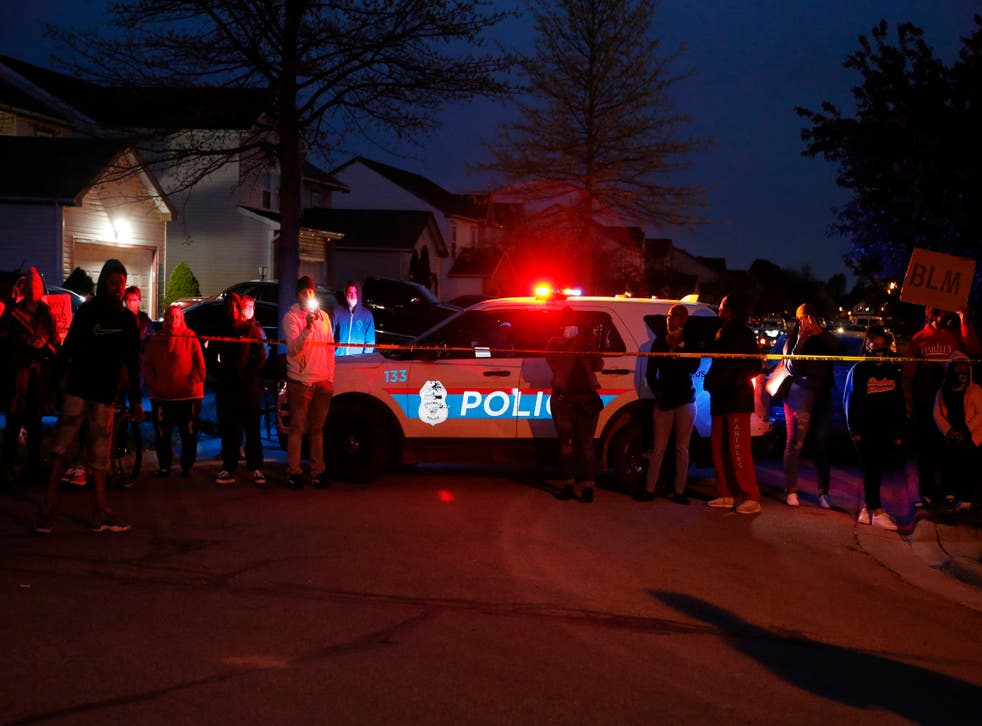 <p>A crowd gathers to protest in the neighbourhood where a Columbus police officer fatally shot a teenage girl on Tuesday</p>
