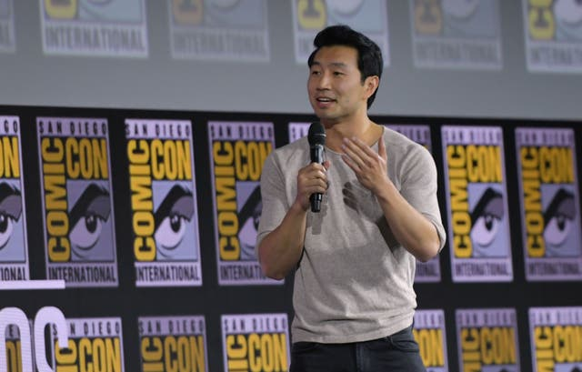 <p>File image: Simu Liu speaks on stage for the Marvel panel in Hall H of the Convention Center during Comic Con in San Diego in 2019</p>