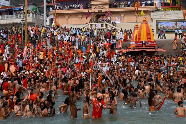 <p>Naga Sadhus (Hindu holy men) take a holy dip in the waters of the Ganges River on the day of Shahi Snan (royal bath) during the religious Kumbh Mela festival</p>