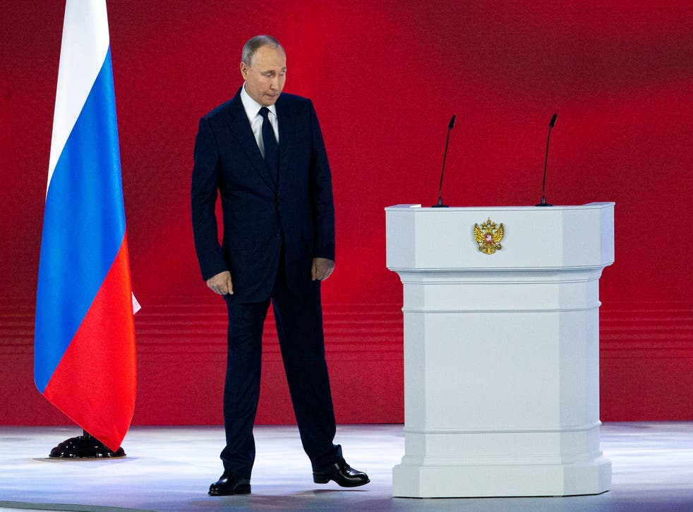<p>Russian president Vladimir Putin leaves the hall after his annual state of the nation address today (21 April)</p>