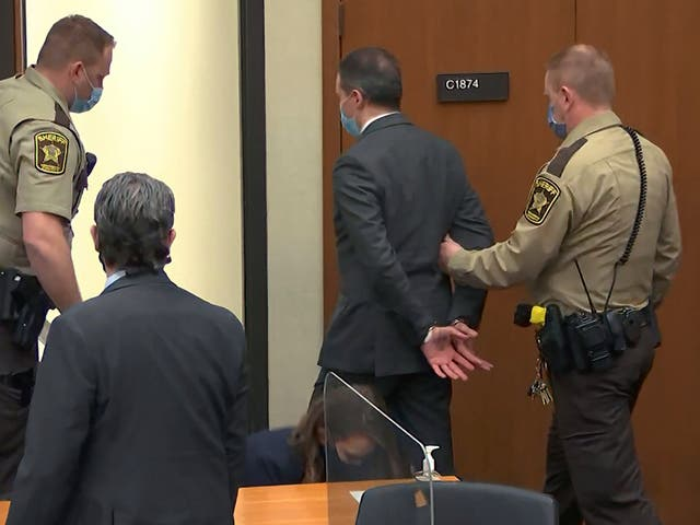 <p>Derek Chauvin listens to the guilty verdict being read by judge Peter Cahill</p>