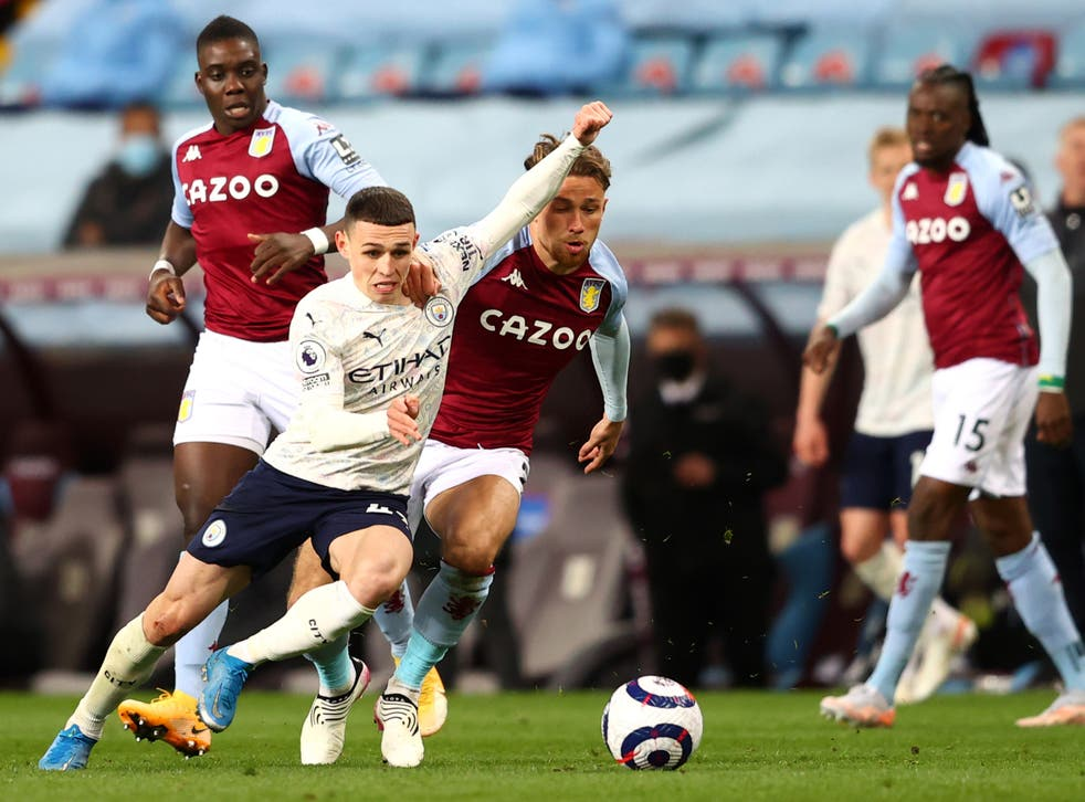 Midfielder Phil Foden on the ball for Manchester City