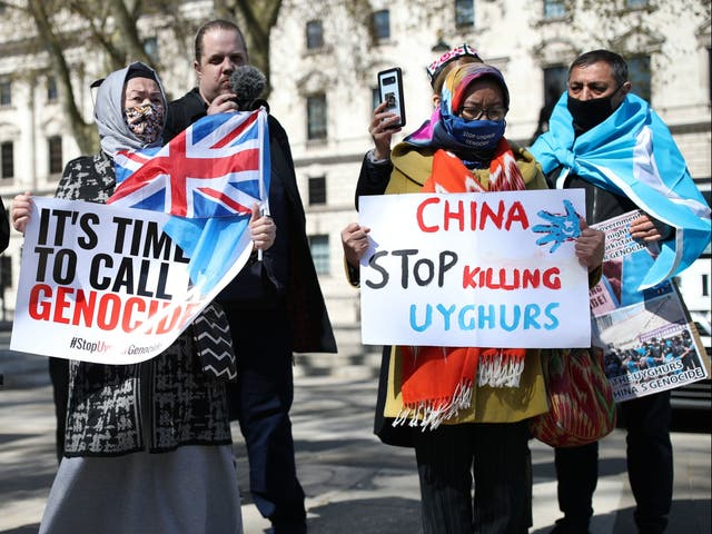 <p>People protest in London against the atrocities carried out by China in Xinjiang province. </p>