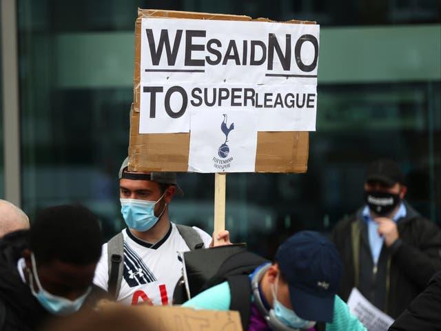 <p>Football fans voice their anger outside Tottenham Hotspur Stadium</p>