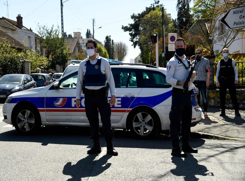<p>French police officials close a street near a police station in Rambouillet after the fatal stabbing</p>