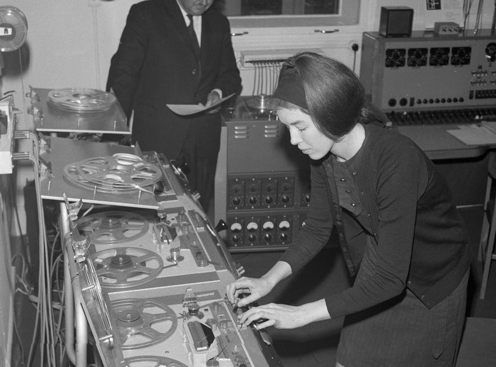 Delia Derbyshire composes using multiple reel-to-reel tape machines in 1965