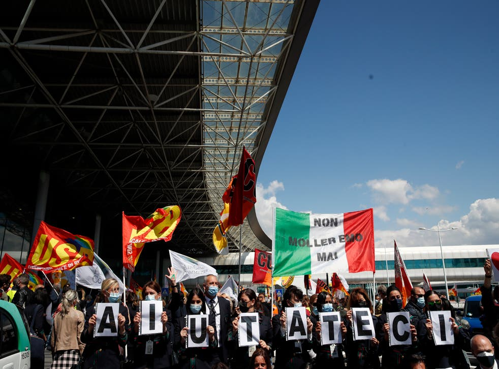 <p>'Help us': Alitalia workers stage a protest at Rome's airport in April</p>