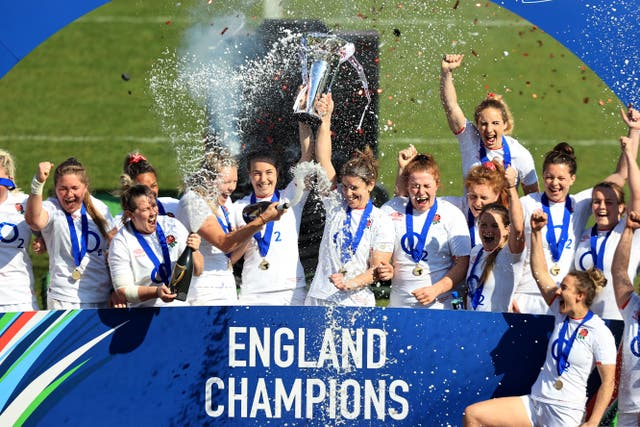 Emily Scarratt and Sarah Hunter of England lift the Six Nations Trophy