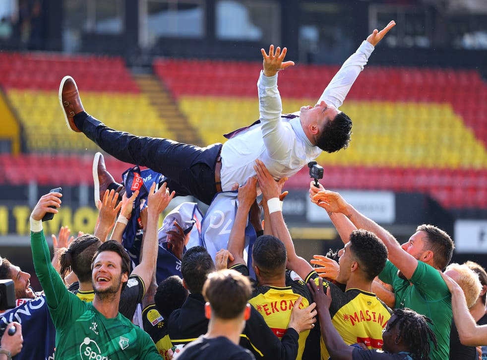 Xisco Munoz is thrown into the air by his players after clinching promotion