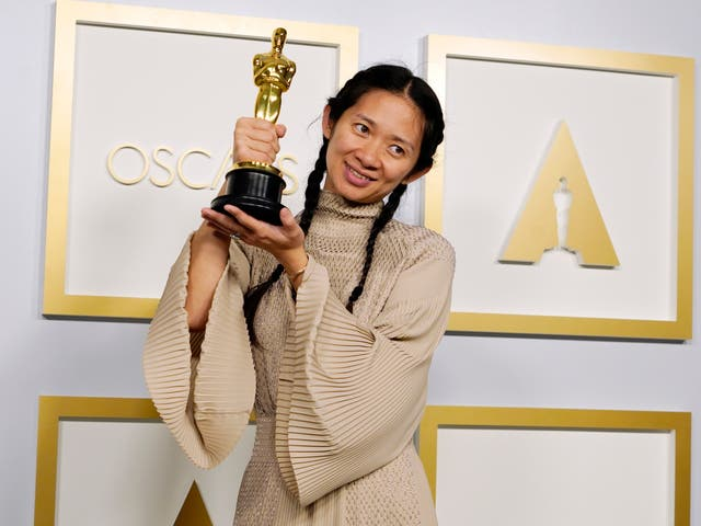 Chloé Zhao poses after winning the Academy Award for Best Picture for Nomadland