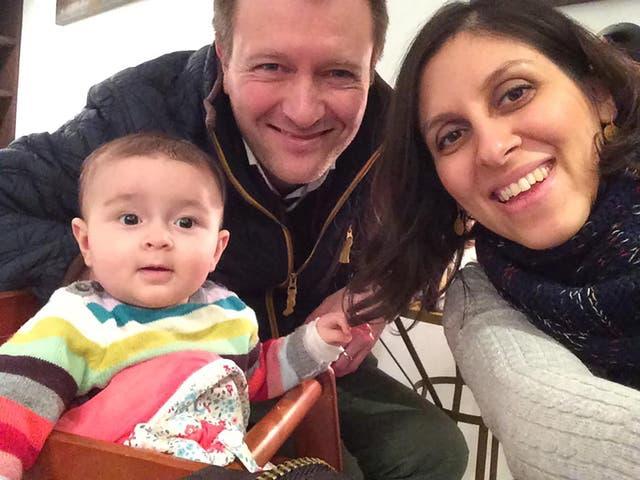 Nazanin Zaghari-Ratcliffe (R) posing for a photograph with her husband Richard and daughter Gabriella