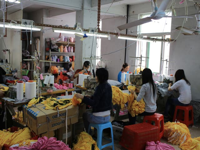 Garment workers work in a small clothing factory in China. A cross-party group of MPs and peers are calling on fast fashion giants to do more to ensure garment workers in their supply chains can earn a living wage