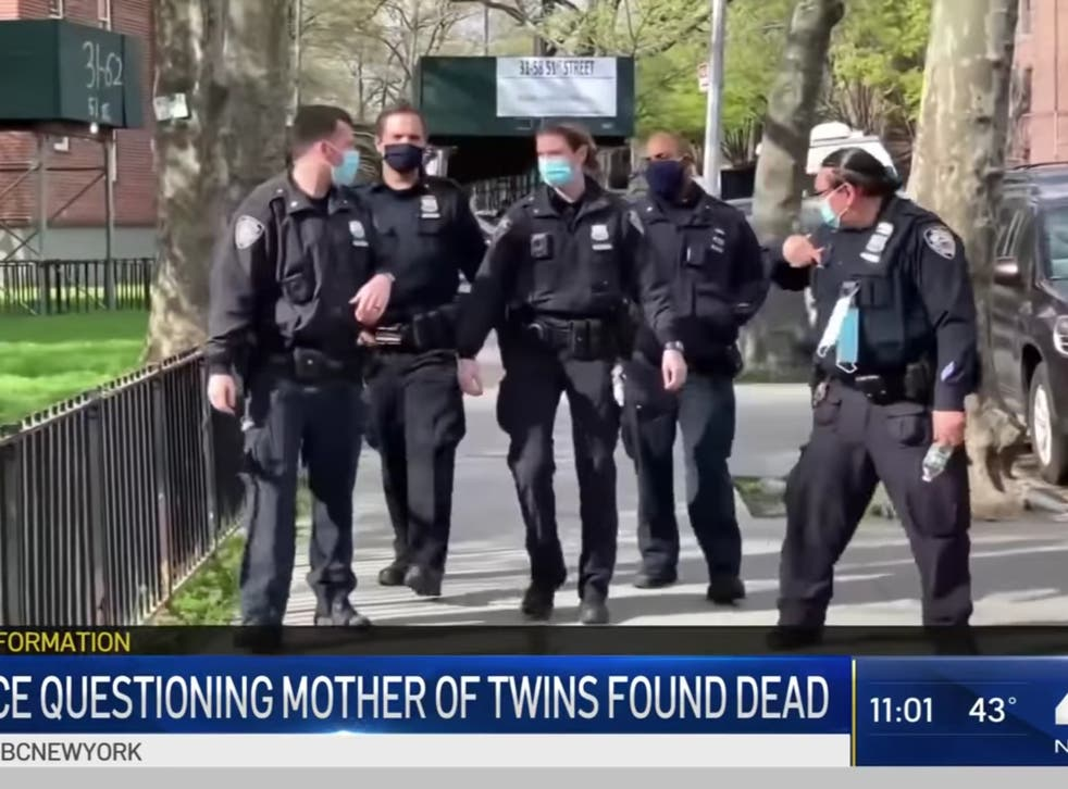 <p>Officers search an apartment after deaths of twins in Queens, New York</p>