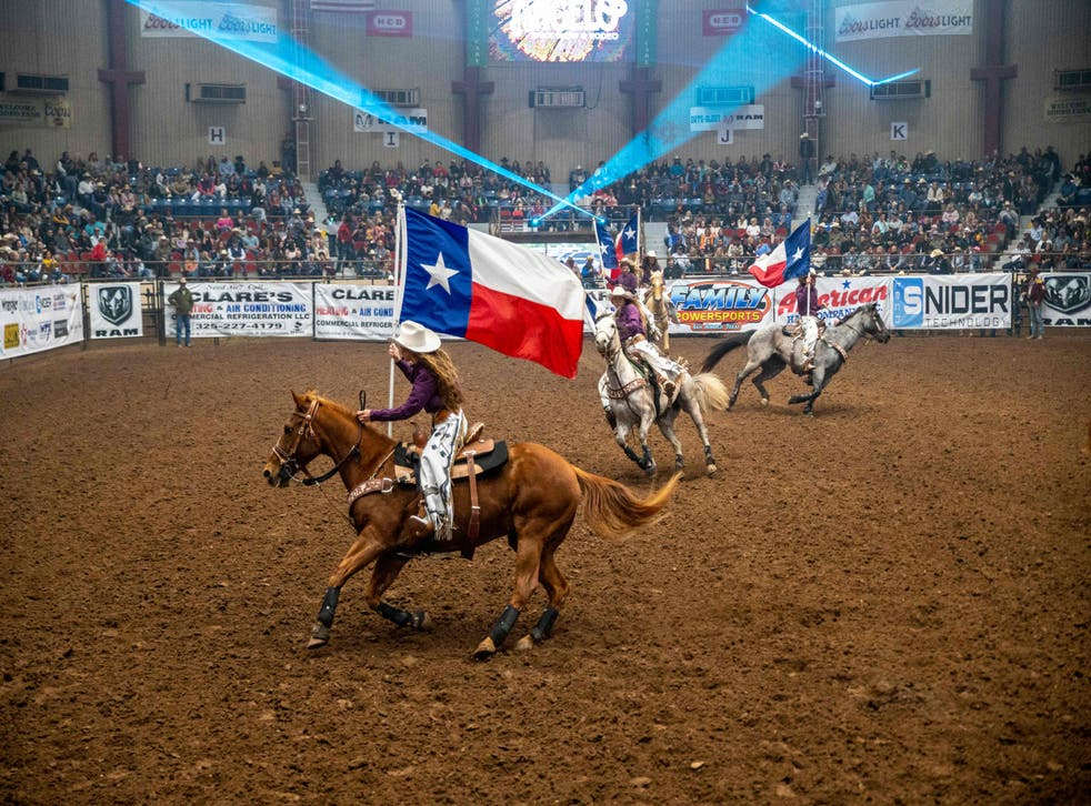 Riders carry the Texas state flag during the opening ceremony of the San Angelo Stock Show and Rodeo, April 16, 2021 in San Angelo. The Lone Star state will get two new congressional representatives as a result of the latest census