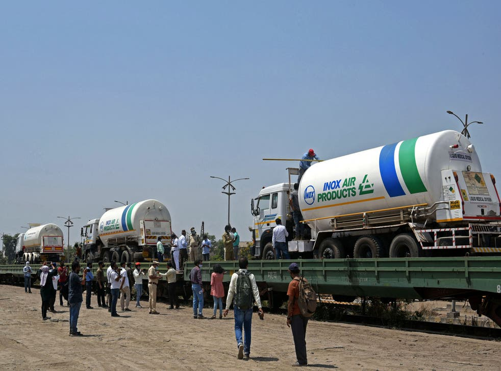 <p>Oxygen tankers being boarded on a special 'oxygen' train at a goods yard in Navi Mumbai </p>