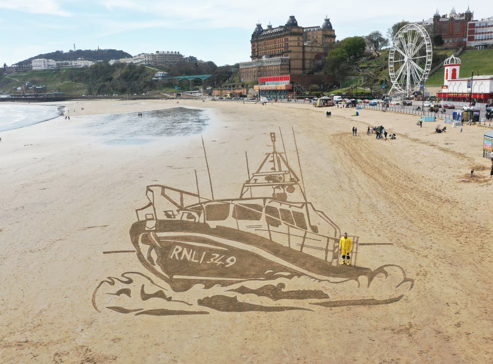 RNLI boat drawn in sand
