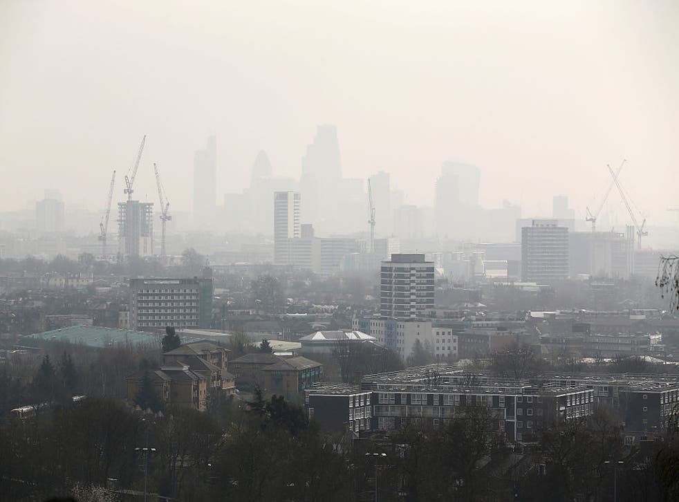 <p>Air pollution and smog blankets the City of London, campaigners are calling for legal limits on air pollution in the UK </p>