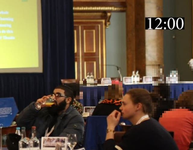 <p>A photo shown in court during the inquest shows Usman Khan  and Saskia Jones sat at a table together at the November 2019 prisoner rehabilitation event near London Bridge</p>