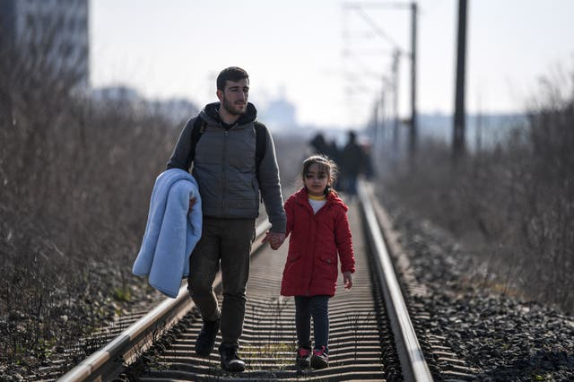 Migrants walk on railways toward Meritsa river, near Edirne, to take a boat to attempt to enter Greece by crossing the river on March 1, 2020. KS, a father of three young children had tried to cross into Greece from Turkey with his own family.