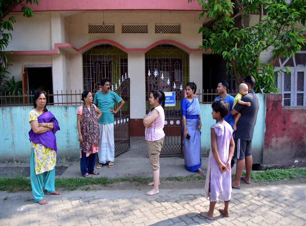 Residents are seen after vacating their houses following an earthquake in Nagaon district, Assam