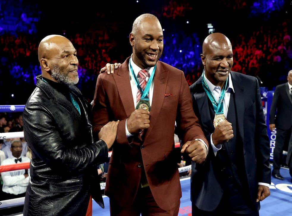 <p>Mike Tyson with Lennox Lewis and Evander Holyfield in February 2020</p>