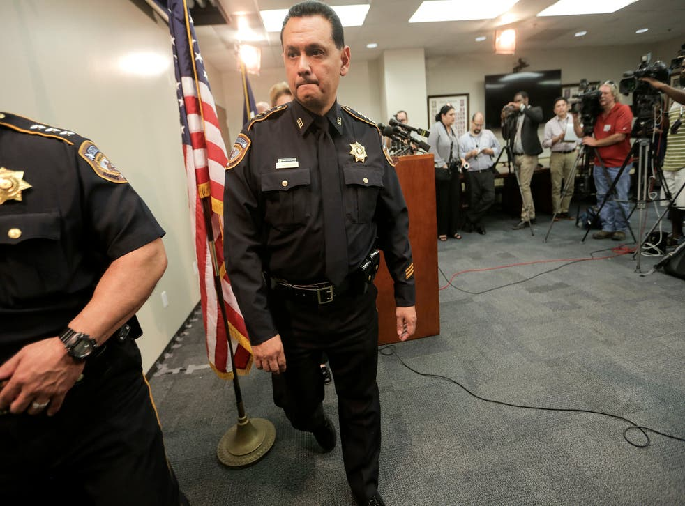 FILE - In this June 8, 2017, file photo, Harris County Sheriff Ed Gonzalez leaves a news conference, in Houston. President Joe Biden has nominated Gonzalez, a sheriff of one of the nation's most populous counties, to lead the agency that deports people in the country illegally. Gonzalez is Biden's pick for director of U.S. Immigration and Customs Enforcement, an agency that has been without a Senate-confirmed leader since 2017. (Elizabeth Conley/Houston Chronicle via AP, File)