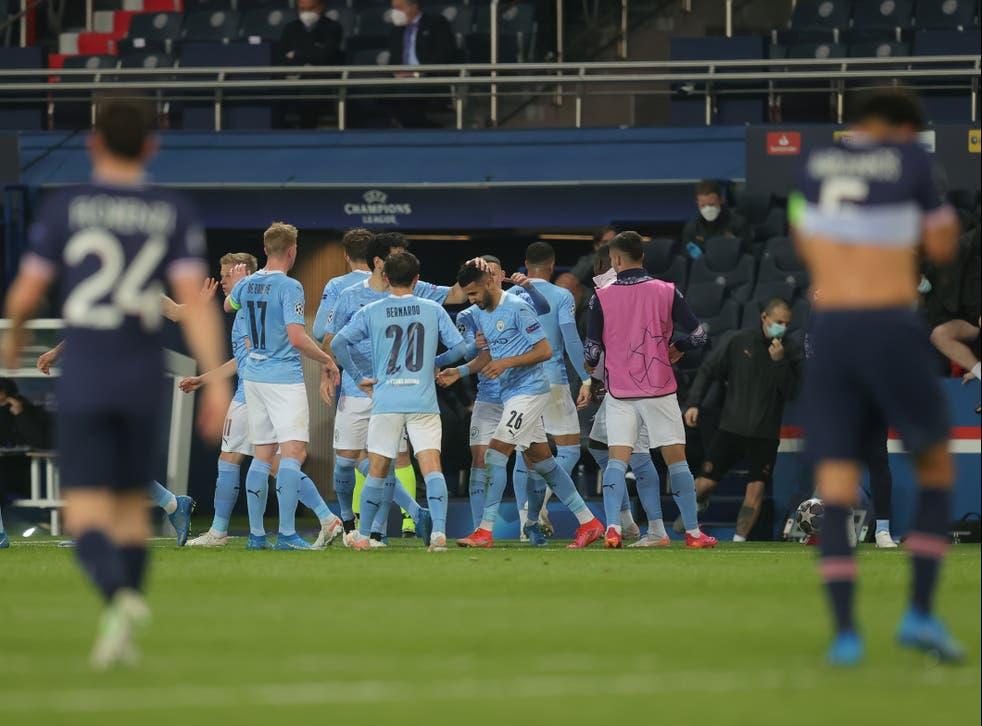 Manchester City players celebrate scoring against Paris Saint-Germain