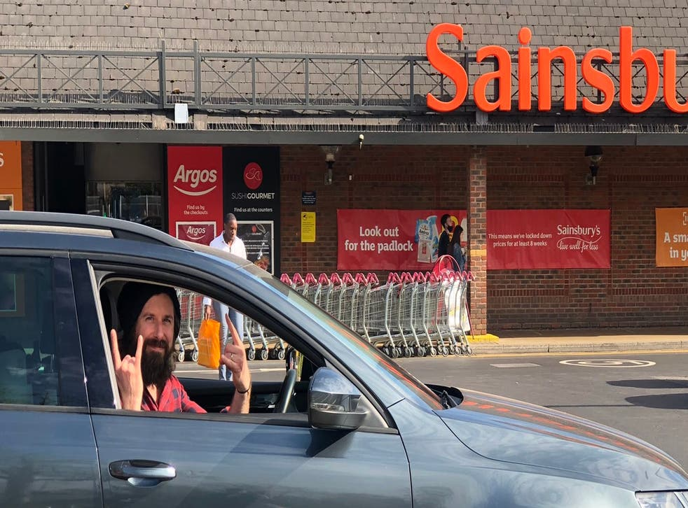 Gareth Wild, 39, pictured in his car at the Sainsbury's in Bromley.