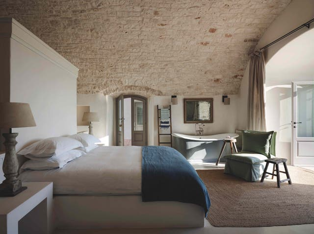 <p>The natural stone walls of 300-year-old Puglia farmhouse speak for themselves</p>