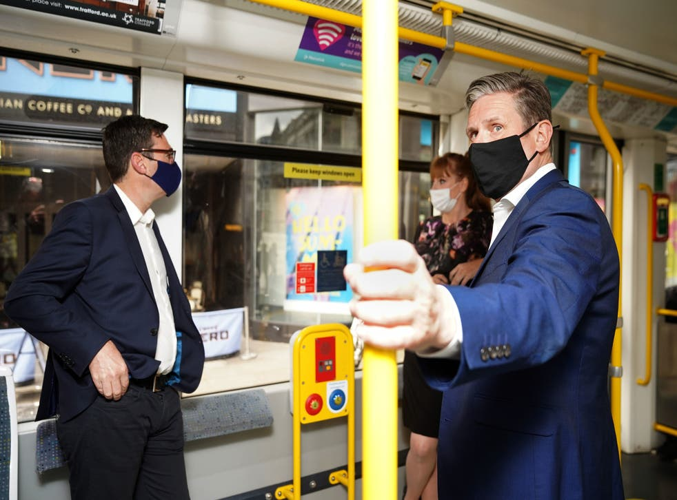 <p>Keir Starmer campaigning with Andy Burnham in Manchester, whose mayoral election is likely to be a 'Labour hold'</p>