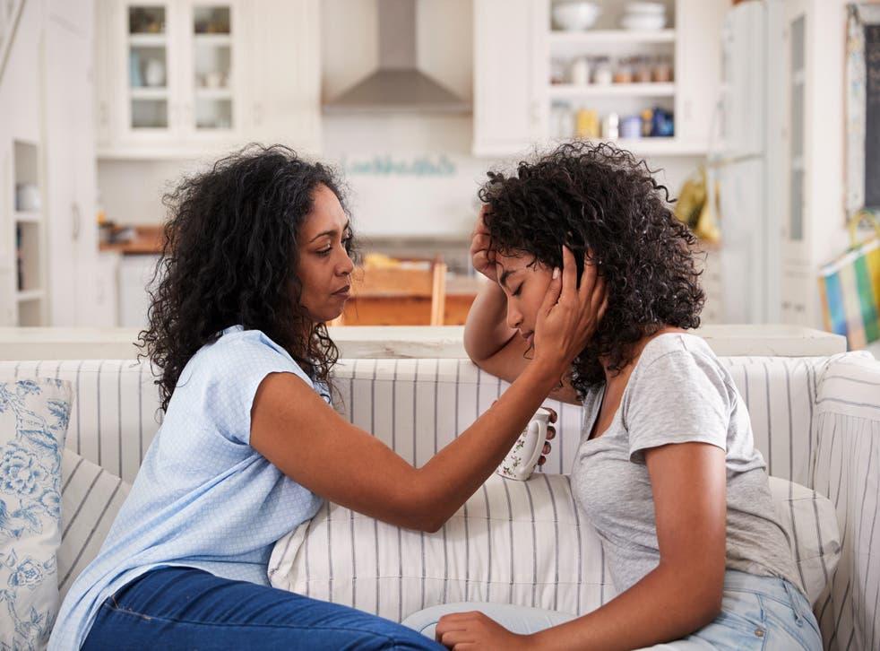 Mother comforts her heartbroken daughter