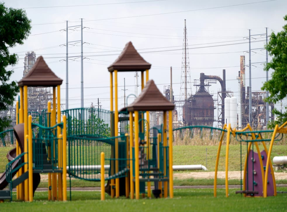 <p>In this Monday, March 23, 2020 file photo, a playground outside the Prince Hall Village Apartments sits empty near one of the petrochemical facilities in Port Arthur, Texas. According to a study published Wednesday, April 28, 2021 in the journalScience Advances, across America, people of color are disproportionately exposed to air pollution from industry, vehicles, construction and many other sources. (AP Photo/David J. Phillip)</p>