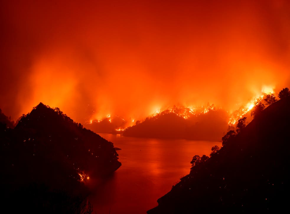 Flames surround Lake Berryessa during the August 2020 wildfires, part of which was started to cover up a murder