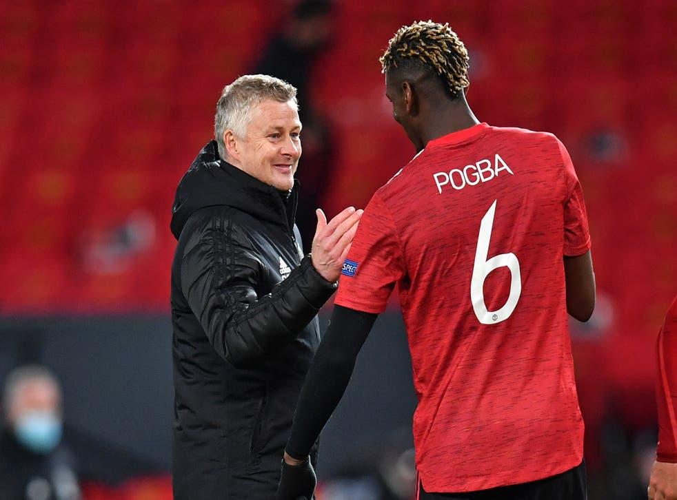 Ole Gunnar Solskjaer congratulates Manchester United midfielder Paul Pogba