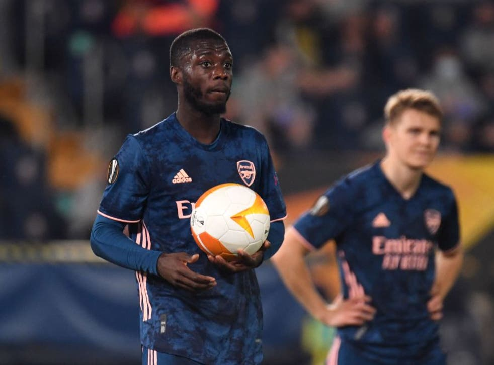 <p>Nicolas Pepe reacts after scoring from the penalty spot</p>
