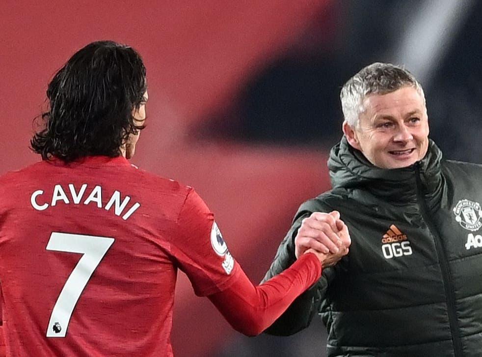 Manchester United coach Ole Gunnar Solskjaer with Edinson Cavani