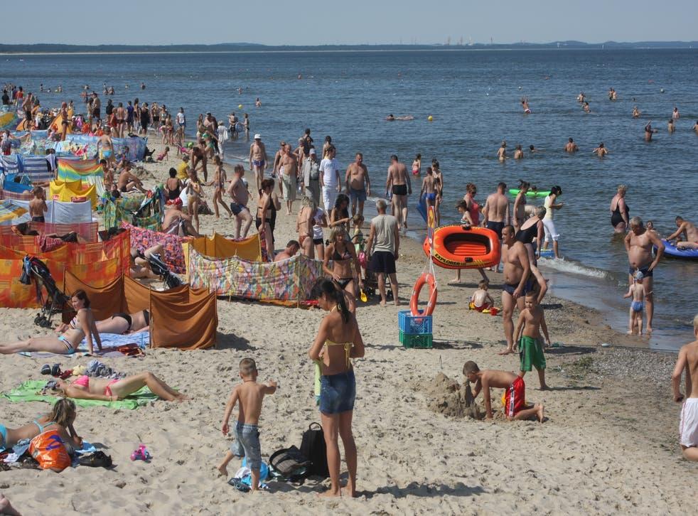 <p>The way we were: Families on a European beach</p>