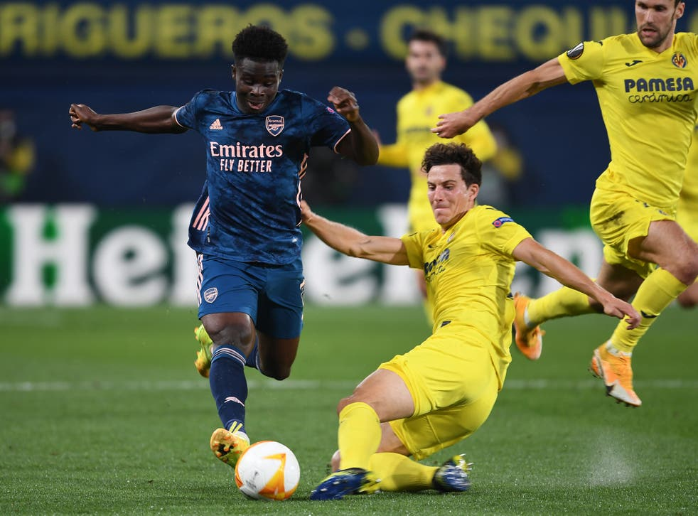 Villarreal defender Pau Torres tackles Arsenal's Bukayo Saka