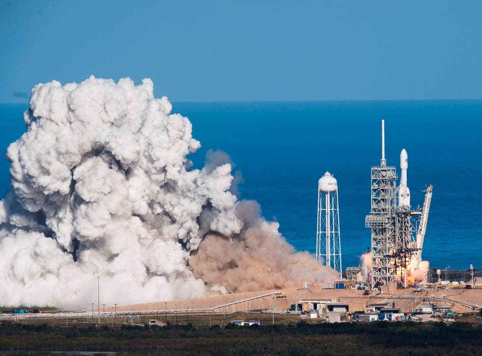 <p>SpaceX's Falcon Heavy blasts off in 2018, carrying a Tesla roadster to an orbit near Mars</p>