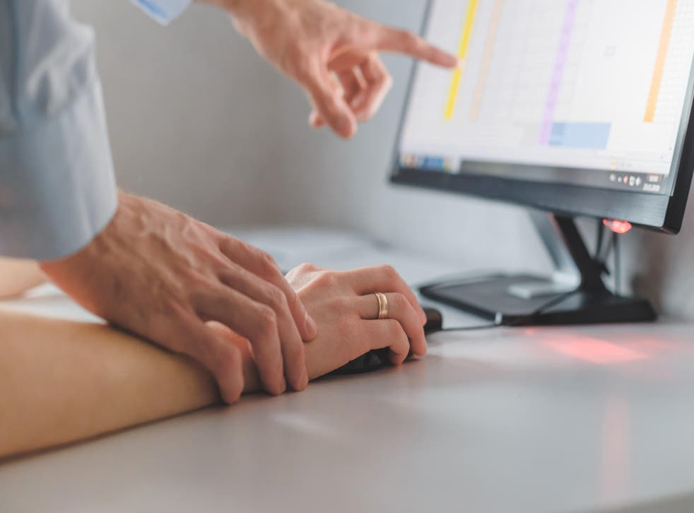 Man touching woman's hand while working