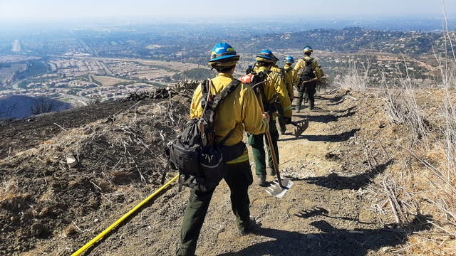 CCC crews from the Los Padres in San Luis Obispo hike to flames of the Blue Ridge Fire that burned nearly 14,000 acres in Orange County neighborhoods