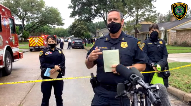 Houston Police's Daryn Edwards outside a home where 91 people were found in possible human smuggling case