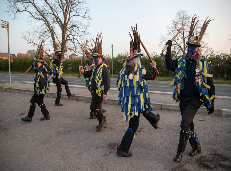 Members of the Hook Eagle Morris Men perform outside the Shack Cafe near to Hook in Hampshire
